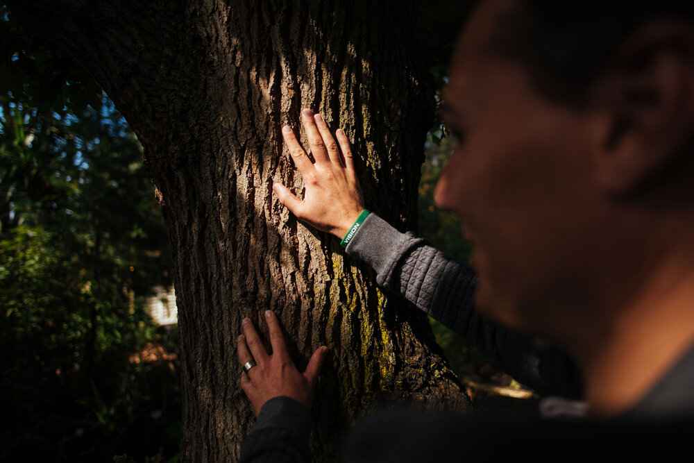 Hein touching the bark of a tree